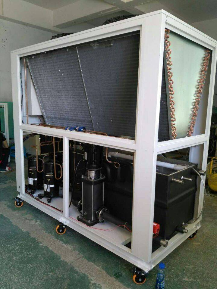 20TR air cooled chiller with 4 scroll compressors,SS tank coil & pump for semiconductor to Singapore