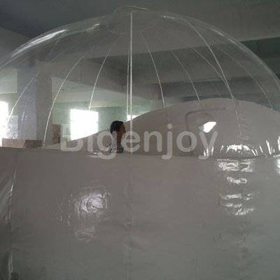 Clear inflatable bubble tent on the lawn