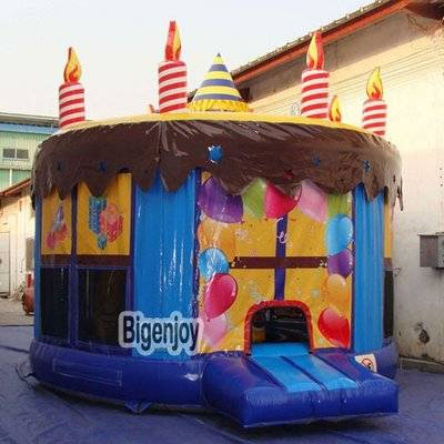 Inflatable birthday cake moon bouncer